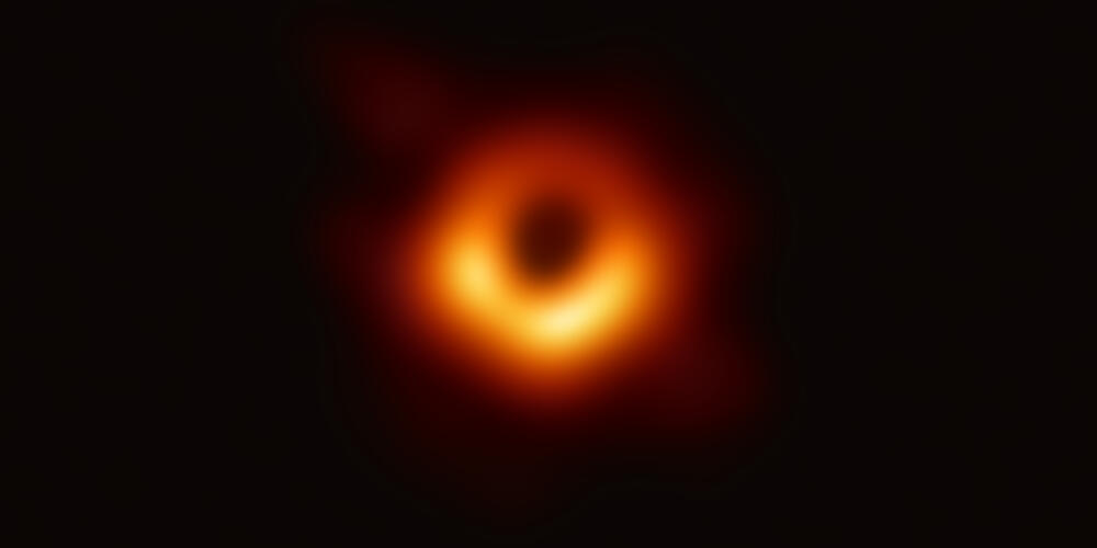 This ring-like structure with a dark central region shows the shadow of the event horizon of the supermassive black hole in galaxy M87.