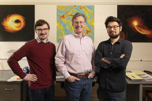 Professor Charles Gammie, center, and graduate students Ben Prather, left, and Charles Wong, right.